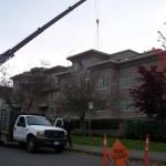 Make-up air unit installation by crane, 2011-11-02
